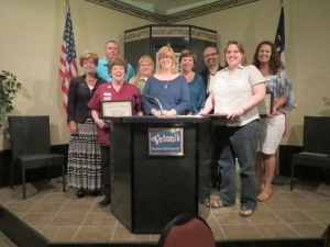 Monitor Photo/Susan Harrison Cedar Creek Lake Area Chamber of Commerce president Jo Ann Hanstrom (center front row) presents the 2012-13 Leadership Class with plaques July 11. Graduates pictured (front row from left) are Linda Fernald, Hanstom, Rev. Dana Coker, (middle row from left) Becky Hepker, Mendy Davis, Gina Dieterich, Laura Capehart, (back row from left) Will Grissom and Rich Casey. Not pictured are Timothy Cline, Tobi Story, Bruce Lawrence and Sherry Andrus.